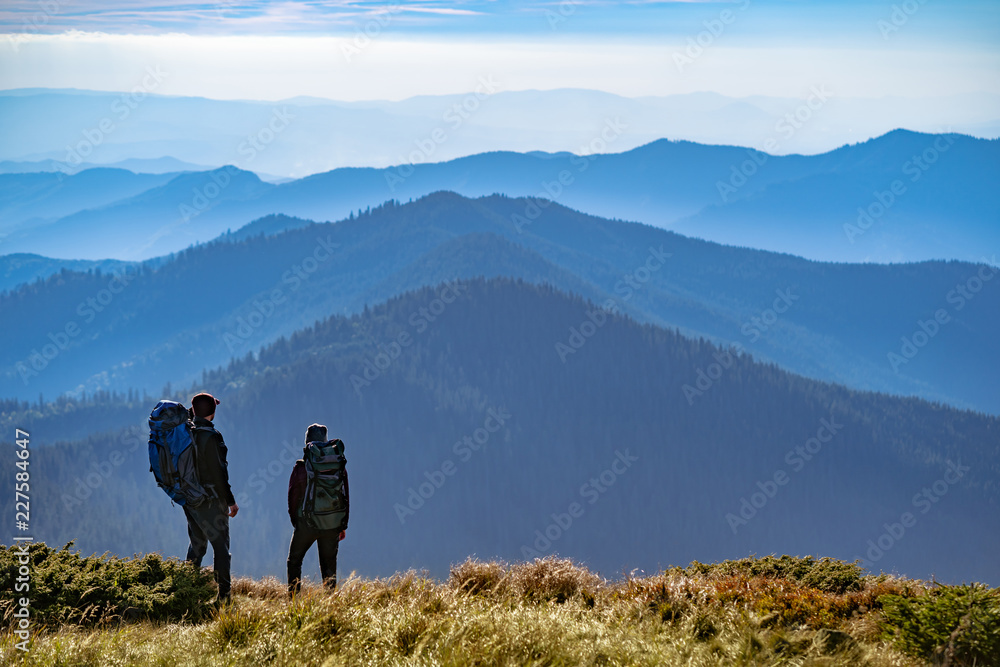 Fototapety, obrazy: The two people standing on the mountain