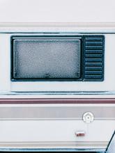 Frost-Covered Camper Van Window