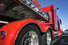 Red Big Rig Semi Truck With Alumnum Flat Bed Semi Trailer Standing For Rest On Truck Stop