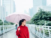 Asian Teenage Girl With Umbrella In Rainy Day