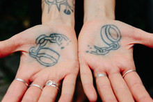 A Tattoo Of Broken Handcuffs O...
