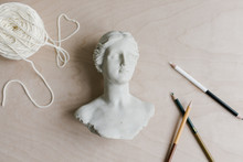 Creative Artist Desk With Marble Statue Of Woman, Colored Pencils And Yarn