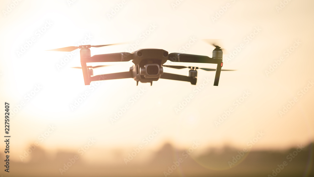 Fototapety, obrazy: Drone like Mavic 2 Pro flying during sunset.
