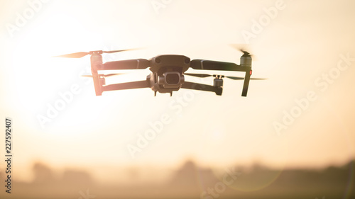Drone like Mavic 2 Pro flying during sunset. Poster Mural XXL