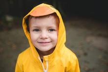 Portrait Of Smiling Boy In Yel...
