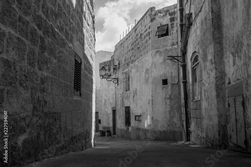 An old narrow street in Siggiewi, Malta in black and white