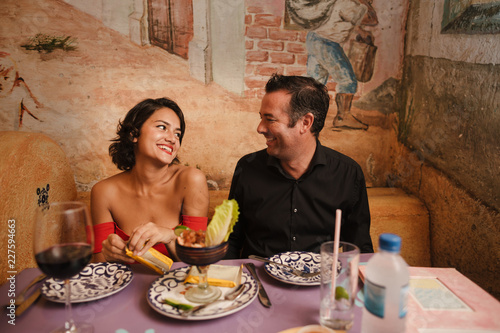 Happy romantic couple on fancy date in mexican restaurant