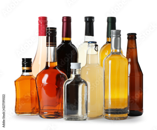 Foto op Plexiglas Bar Bottles with different alcoholic drinks on white background