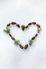 Heart Made Of Pinecones And Pine Needles In The Snow