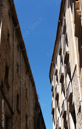 Blue sky between old buildings