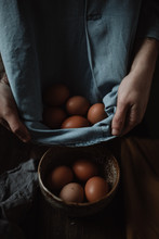 Putting Eggs Into A Bowl