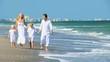 Loving Family Walking on the Beach