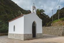 Small White Chapel With Mounta...