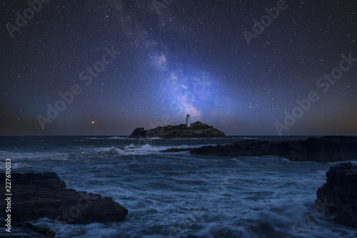 Türaufkleber Blaue Nacht Vibrant Milky Way composite image over landscape of Godrevy Lighthouse in Corwnall England