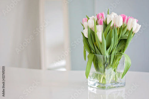 Fotografie, Obraz  White and pink tulips on a white table were used as a Spring decoration backgrou