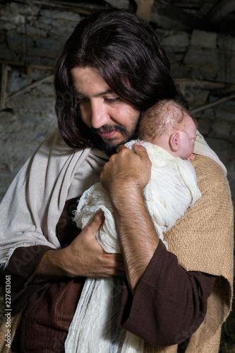 Canvas Print Joseph hugging baby Jesus