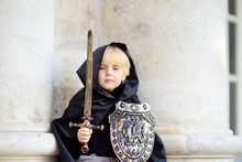 Portrait Of A Cute Little Boy Dressed As A Medieval Knight