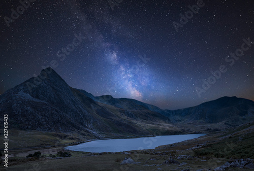 Foto op Aluminium Nachtblauw Digital composite Milky Way image of Stunning landscape image of countryside around Llyn Ogwen in Snowdonia