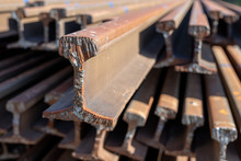 Railway Tracks Stored At The Railway Station. The Place Of Cutting Rails With A Gas Burner.