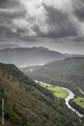 Foto op Plexiglas Grijs Landscape image of view from Precipice Walk in Snowdonia overlooking Barmouth and Coed-y-Brenin forest during rainy afternoon in September