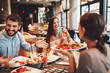 canvas print picture - Group of Happy friends having breakfast in the restaurant