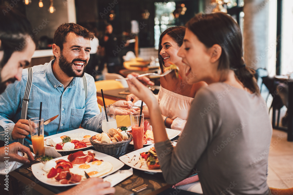 Fototapety, obrazy: Group of Happy friends having breakfast in the restaurant