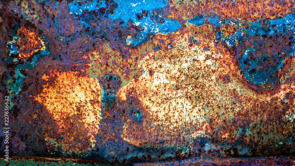 Original textured background of painted rusty galvanized metal with blue paint spots