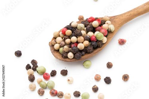 Fotobehang Kruiderij Pepper mix seed on spoon on white background.