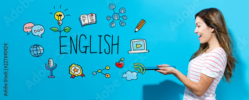 Photo  English with young woman using her tablet