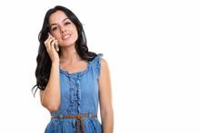 Studio Shot Of Happy Beautiful Spanish Woman Smiling While Talki