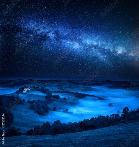 Milky way, falling stars and foggy valley, Italy