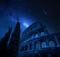 Fototapeta Colosseum in Rome with milky way and falling stars, Italy