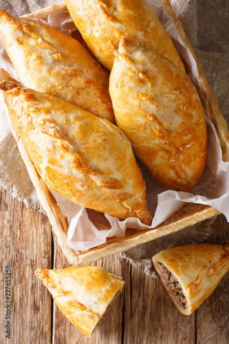 Lithuanian kibinai traditional pies with lamb meat close-up. Vertical top view