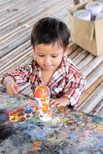 Asian Toddler Boy Painting Watercolor On Plaster Doll