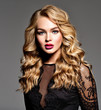 canvas print picture Blond woman with long curly beautiful hair.