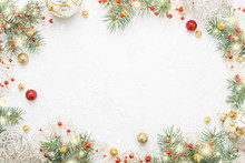Christmas Frame Of Spruce, Red And Gold Decorations On White Background. Copy Space. New Year Lights. Flat Lay.
