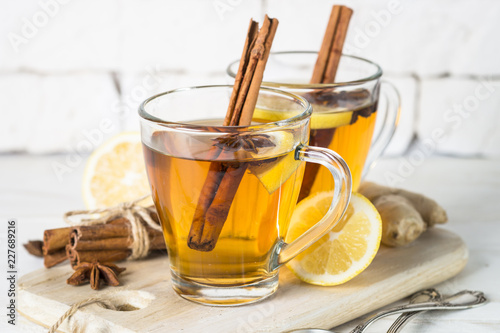 Spoed Fotobehang Thee Autumn hot tea with lemon and spices