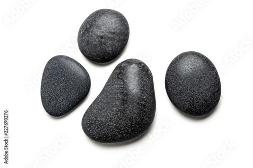 Fototapeta Four big black pebbles