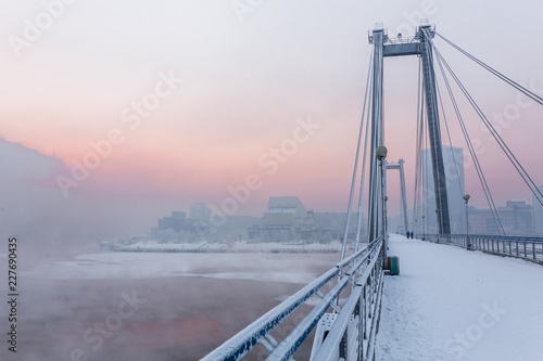 Fototapeta Cable-stayed bridge across the Yenisei river in the winter morning. Krasnoyarsk, Krasnoyarsk Krai, Russia. obraz