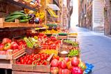 Fototapeta Uliczki - Fruit and vegetable market in narrow Florence street
