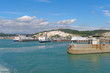 Three ferries at the port of Dover on a sunny day.