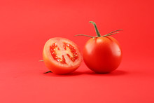 Tomato On Red Background. Ital...