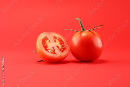 tomato on red background Canvas