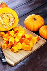 Fototapeta Pumpkin and pumpkin slices Autumn Healthy Food Nutrition Seasonal Vegetable Concept