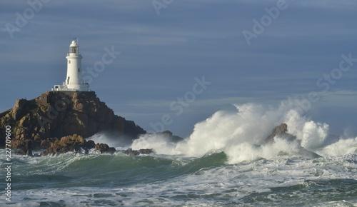 Foto op Aluminium Vuurtoren La Corbiere lighthouse, Jersey, U.K. Storm Callum pounds the coast.