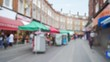 Scene of popular street market in Brixton, London, out of focus