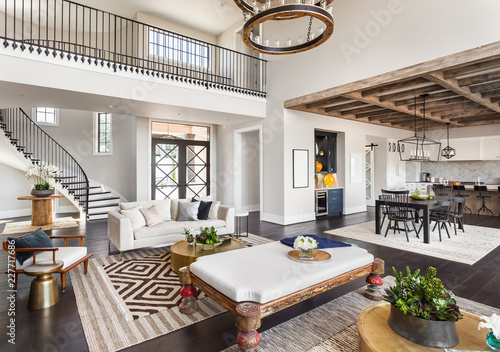 Obraz Stunning living room interior panorama showing entry, dining room, and kitchen of home with open concept floor plan - fototapety do salonu