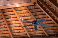 Ceiling Fan Hanging From Wood Roof In The Room Interior