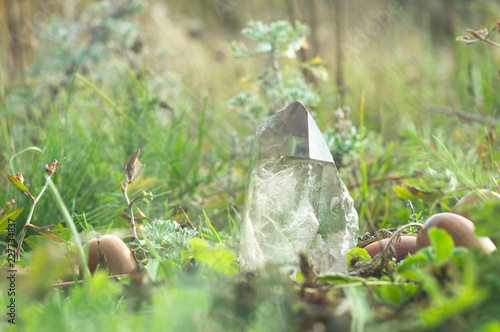 Large clear pure transparent great royal crystal of quartz chalcedony diamond brilliant on nature blurred bokeh autumn background close up