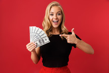 Excited Woman Holding Money Is...